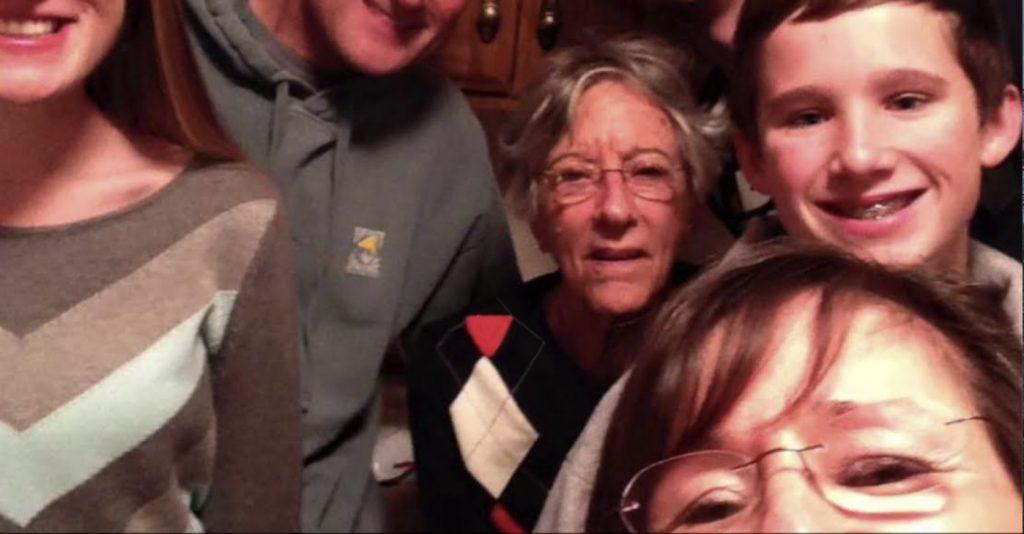Charter Senior Living of Cleveland Video Thumbnail Family Group Surrounded by senior living resident